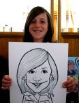 girl holds her portrait grinning widely